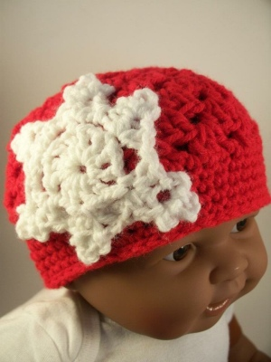 "Green Crochet Baby Hat with Snowflake. 16"" circumference. $18.00."